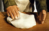 puppet's hands making bread